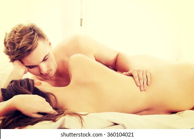 Young couple lying on bed.