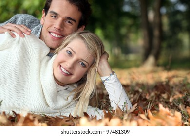 Young couple lying on the grass together