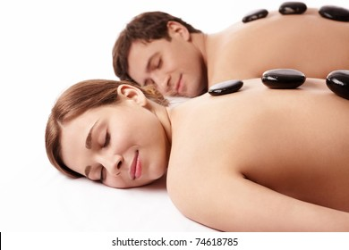 Young couple makes treatments on a white background