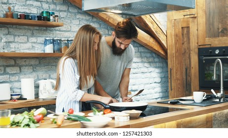 Young couple making dinner together at home