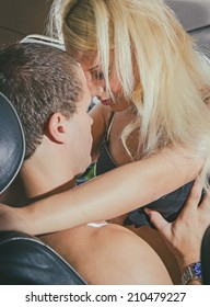 Young couple making love in the car.