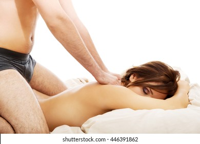 Young couple making massage at home.