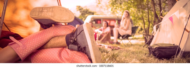 Young couple making out in tent at a music festival