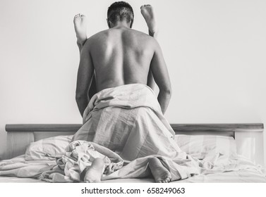 Young couple making passionate sex in hotel room - Handsome lovers having sexual romantic moments - Relationship under the cover concept - Soft focus on man head, woman feet - Warm contrast filter