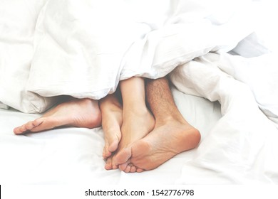 Young couple making sex under blanket in bedroom. Sleeping spouses in their bed. Happy family lifestyle. a family showdown ends in bed
