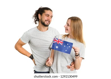 Young couple man and woman with Australia flag, isolated on white background.