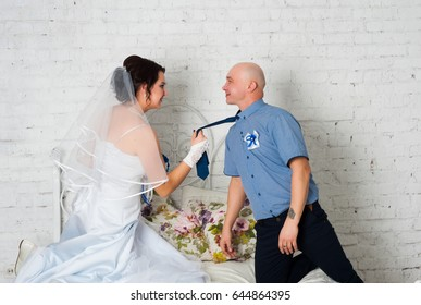 Young couple marrying and playing a wedding dress each other wedding bands and very happy