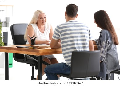 Young couple meeting with consultant in office