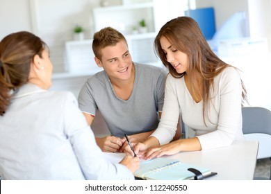 Young couple meeting financial consultant for credit loan
