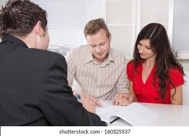 Young couple in a meeting - insurance or bank for investments