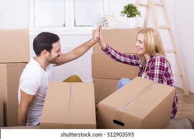 Young couple moves into new home. Home, people, moving and real estate concept