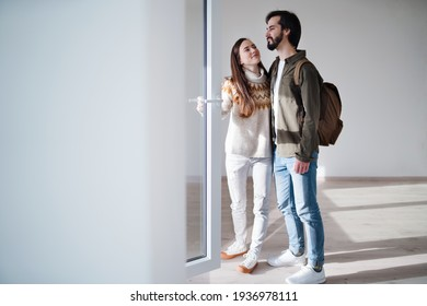 Young couple moving in new flat, new home and relocation concept.
