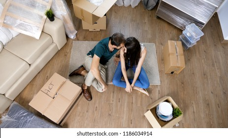 Young couple Moving in new home and unpacking carboard boxes. Almost done moving in.