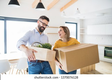 A young couple moving in new home.