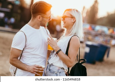 Young couple at the music festival having fun