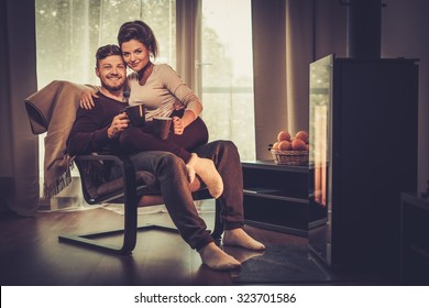 Young couple near fireplace at home