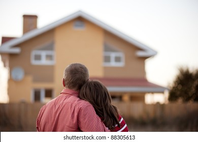 young couple near his house