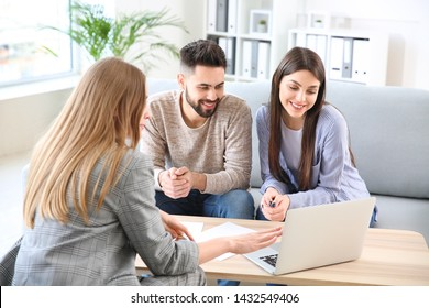 Young couple in office of real estate agent
