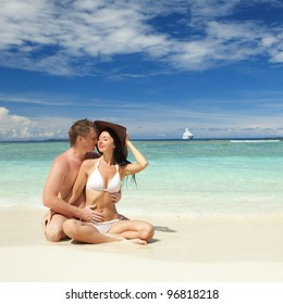 Young couple on the beach of sea