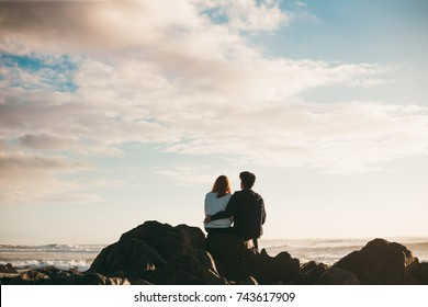 Young couple on beach at sunset
