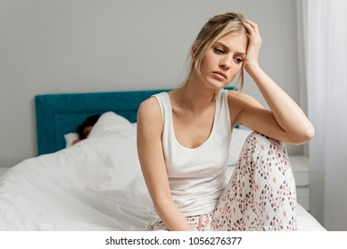 Young couple on the bed; problems in the bedroom