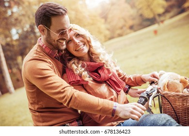 Young couple on a bike ride on a sunny day.