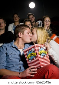 Young couple on a date at the movie theater