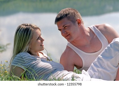 young couple on a grass