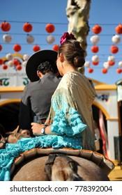Young couple on horseback at Sevilla Fair, Andalusia, Spain