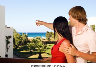 young couple on hotels terrace