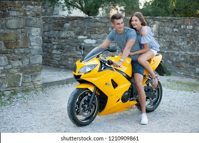Young couple on a motor bike on a late summer afternoon