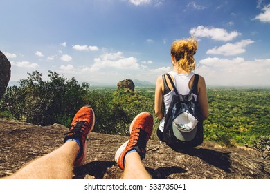 Young couple on a mountain overlooking nature and Sigiriya rock