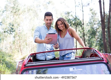 Young couple on roadtrip through countryside