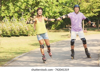 Young couple on roller skates in park