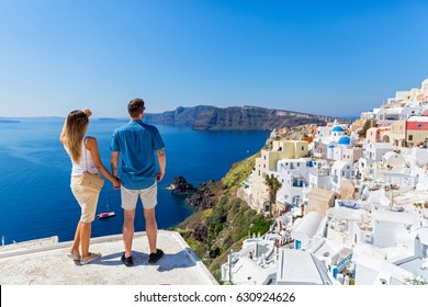 Young couple  on the roof of the building in Santorini, Greece.