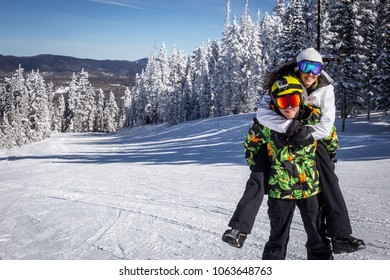 Young Couple On Ski Holiday In Mountains. Bluebird day