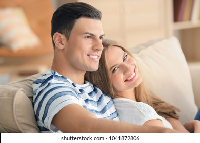 Young couple on sofa at home