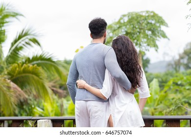 Young Couple On Terrace Tropical Hotel, Man And Woman Tropic Holiday Vacation Green Forest
