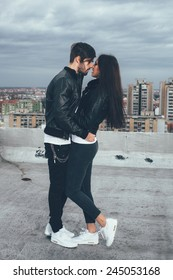 Young couple on top of a building in the embrace