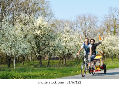 a young couple on vacation in tandem cycling