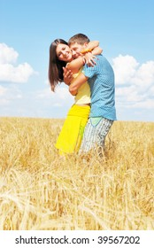 Young couple on wheat field