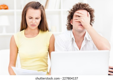 Young couple organizing their bills.