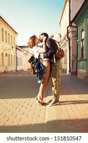 Young couple outdoor sweet kiss in summer