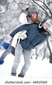 Young couple outdoors fun. Winter season.