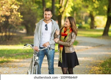 Young couple outdoors posing