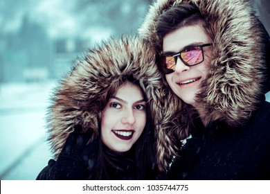 Young couple outside during cold snowy day