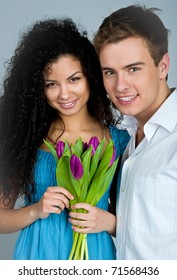 Young couple  over blue background