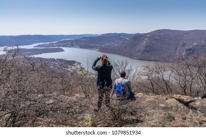 Young couple overlooking Hudson River at Bull Hill near Cold Spring, NY