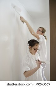 young couple painting room