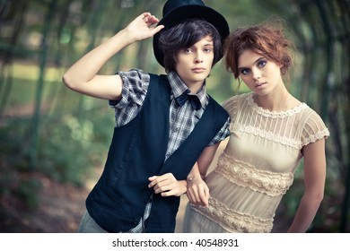 Young couple in a park. Soft yellow tint.